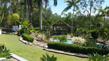 view of pool and pool pavilion from the deck