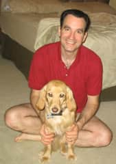 David with one of our past pets-- Golden Retriever/Cocker spaniel mix, Sandy!