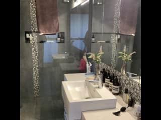 Main bathroom/ensuite to main downstairs bedroom