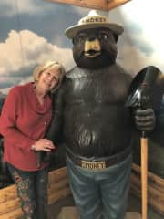 Me with Smoky Bear.  I love to travel, collect antiques, dine at great restaurants and enjoy a good glass of wine.  I lost my house in the California Wine Country fires in October, 2017.  I am currently living with a friend and traveling more.