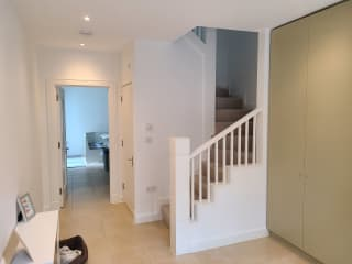 Staircase to upstairs bedrooms.  Door to downstairs half bath.