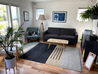 Airy living room connects directly to the dining room. Perfect for after dinner pets