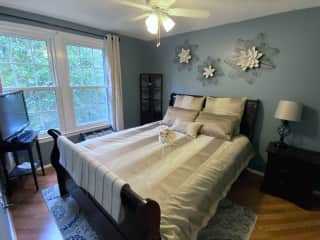 """Guest bedroom. Queen size bed and a 32"""" TV with AppleTV."""
