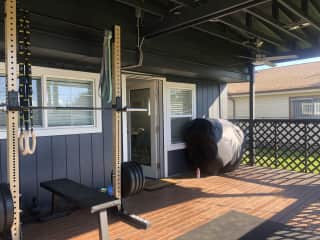 back deck with weight equipment set and outdoor grill