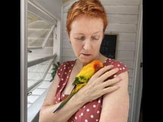 Kirsty cuddles a feathered friend. Brisbane, Queensland, Australia.  December, 2020.