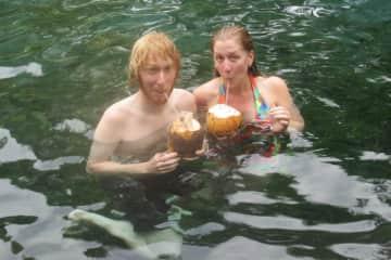 Allison and Derek enjoying fresh coconuts in Nicaragua. We love to travel!