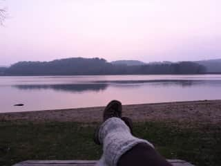 Me at the sunrise in front of a lake in the french Morvan