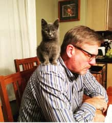 Earl with Thomas, a kitten he rescued from a bike trail.