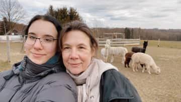 Me and my Mom on one of our many hiking journeys as well as alpacas on an alpaca farm!
