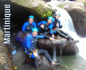 Our family rappelling down waterfalls in Martinique