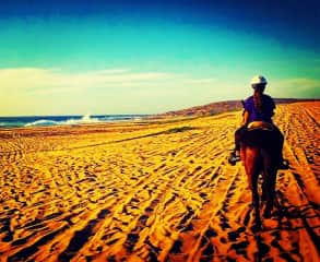 I love to ride horses (this is my daughter in Mexico)