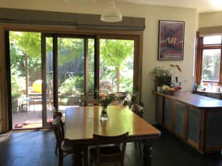 Open plan kitchen, dining and living room with sliding doors to garden.