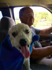 """Kip and our sweet poodle Sunshine who has her """"super-cape"""" on for the truck ride around our pastures."""