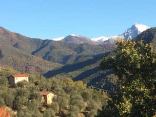 View from nearby walking with snow on mountain tops