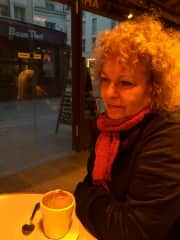 in a parisian cafe working with a colleague/writer on a rainy night