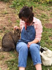 Whitney befriending Tiger cat on the farm