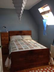 the back bedroom.  This room now has a single bunk that straddles the head of the double bed.