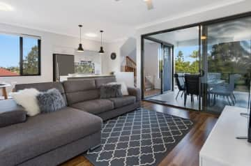 Open plan kitchen and lounge with smart TV