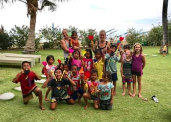In 2017, Andrea lived in Bali and taught yoga to the local children!