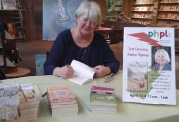Me signing books