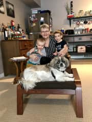 My shih tsu Ozzy (11 years old) and two of my grandchildren.