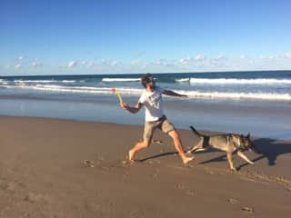 Playing with the beloved dog at the beach