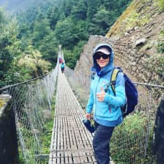 One of Janet's hobbies is trekking. Here she is on her way to Everest Base Camp.