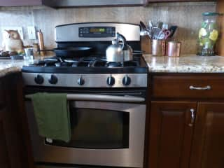 There is a gas stove and toaster oven, but no microwave.