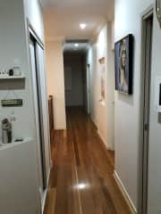 Upstairs hall between kitchen and formal dining room w 2 bedrooms on the right