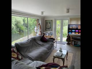 Lounge over looking the river and with access to garden and paddock via the patio doors.