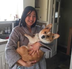 Grace with Ruby the corgi. We watched her for 1 week and LOVED how cuddly she was!