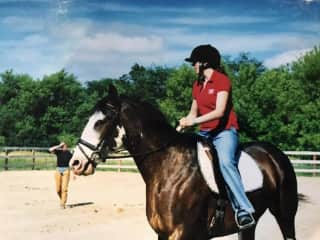 Our daughter, Ashley, riding her horse , Mystery