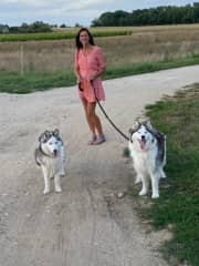 Brigit with the huskys that we cares for 10 days in France