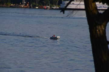 View from our house to BC Ferries. Our son coming home in the inflatable.