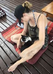 Dawn making friends with the local neighborhood cat in Thailand, 2019.
