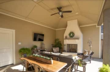 Outdoor living area with pull down screen for easy living and outdoor grilling