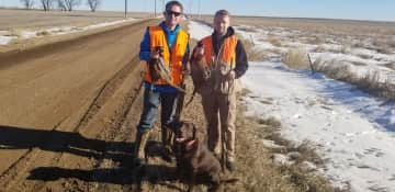 My sons and Champ while pheasant hunting.