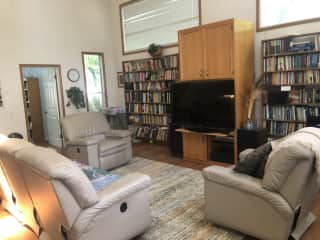 Spacious family room with TV, BOOKS, Elliptical machine, comfy couches to cuddle with Beau on.