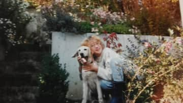 Simone as a kid with her beloved labrador