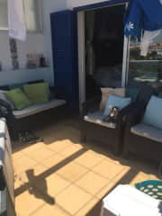 Our balcony. Not a brilliant picture but it is nice and sunny , it has a double sofa and two chairs a small coffee table and a sun lounger . There is a clothes airer and a washing line too.