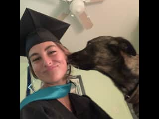 This is me on graduation day with my friends dog, Tex.