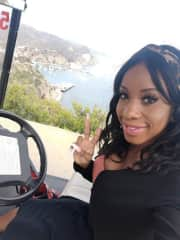 Me driving a golf cart on a hill in Catalina for a photo over looking the island.