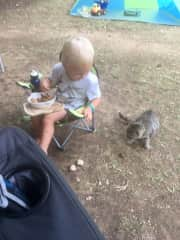 Charlie with a cat on campground