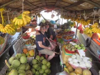 John and Rachel visiting a floating market in the Mekong Delta