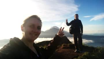 Myself and partner celebrating the summit of Mount Batur