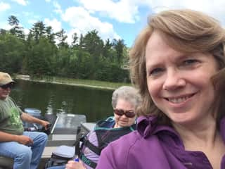 Me with my mother in the background on a lake in Minnesota