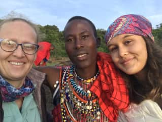 My daughter and I with Julius, a young Maasai, on the Mara Nature Preserve.