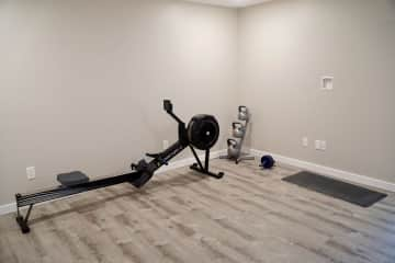 Rowing machine, kettle balls, and yoga mats available