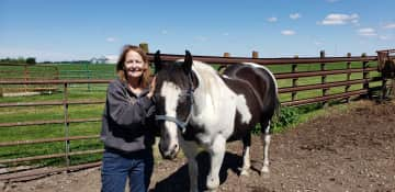 This is my beautiful paint horse, Panda and my girlfriend,  Terri.  Terri and I travel together often and like to house sit together.  She loves animals, especially dogs, more than I do.