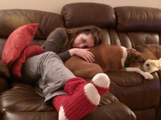 Miko and Kara - Andover, UK.  My adult daughter helped me petsit, and she fell absolutely in love, and they loved her right back. Red socks? It was Christmastime :-)